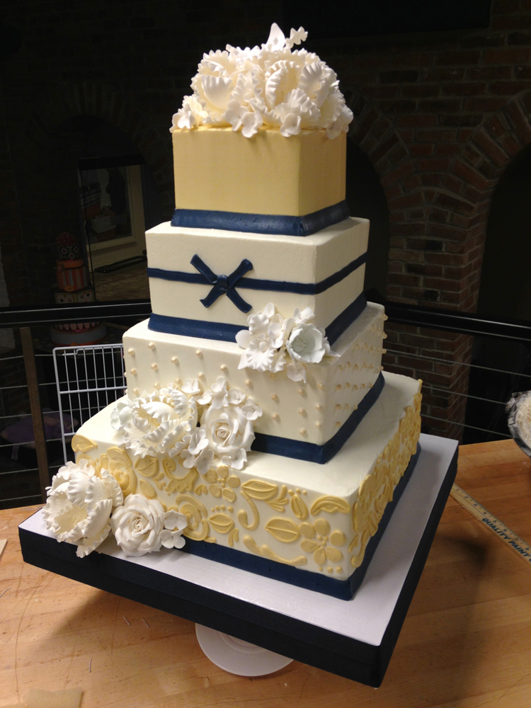 http://whiteflowercake.com/wp-content/gallery/buttercream-wedding-cakes/navy-and-yellow.jpg