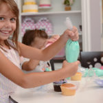 Isabel swirling some delicious buttercream!
