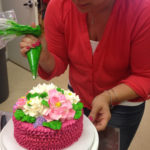 Check out those amazing buttercream ruffles and flowers!